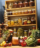 Pickled vegetables and jams on shelves