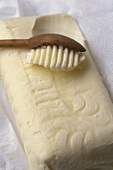 Butter with grooved wooden spoon