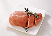 Turkey meat garnished with rosemary