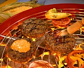 Rissoles with vegetables on the barbecue