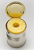 Pineapple slices in an opened tin