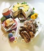 Plum & walnut plait, poppy seed cake & a piece of sponge roll