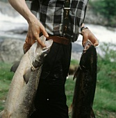 Fisherman with two salmon