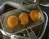Doughnuts in frying basket