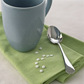Sweetening tablets with cup and spoon