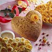 Heart-shaped cake with yellow rose