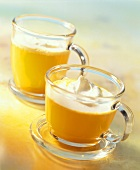 Tea with orange syrup and cream topping