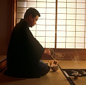 A Japanese man at a tea ceremony