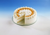 White cream gateau with apricot jam