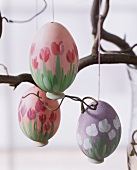 Painted Easter eggs hanging on a branch
