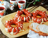 Fried sausage rings larded with cheese