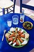 Plate of Greek appetisers and ouzo