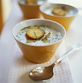 Potato and cheese soup with toasted bread