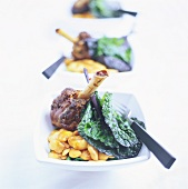 Knuckle of lamb with white beans and ruby chard