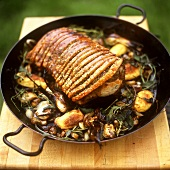 Roast pork with herbs and potatoes