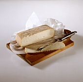 Taleggio on board with cheese knife