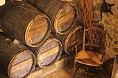 Wine barrels in restaurant La Ferme Aux Grives, France