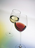 Clinking glasses: a glass of red and a glass of white wine