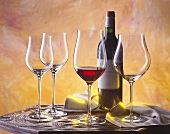 Red wine still life with Bordeaux and glasses on table
