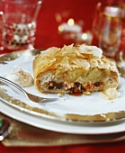 A piece of marzipan apple strudel on festive plate