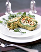 Herb omelette roulade with salmon and vegetable filling