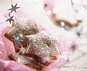 Cinnamon stars on pink wrapping paper