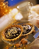Short pastry tarts with chocolate almond filling