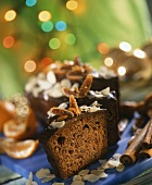 Spiced cake for Christmas with chocolate icing, pieces cut