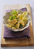 Potato salad with grape seed oil, sprouts and coriander