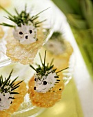 Soft cheese and chive hedgehogs on delicate crackers