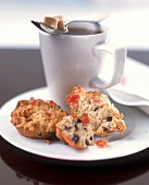 Two fruit muffins and cup of coffee