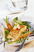 Salmon fillet with vegetables and basil sauce