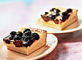 Two pieces of sour cream cake with blackberries