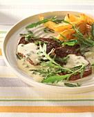 Beefsteaks with gorgonzola sauce, rocket & potato wedges
