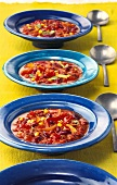 Mexican bean soup on blue plates