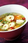 Hot and sour soup with vegetables and omelette strips