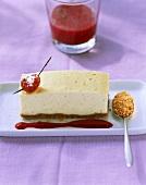 A piece of cheesecake with raspberries & raspberry sauce