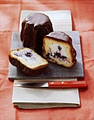 Yeast cakes with chocolate icing & ricotta & blackberry filling