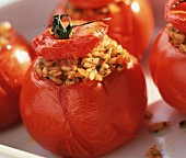 Baked tomatoes with herb and rice stuffing