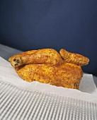 Half a roast chicken on baking paper