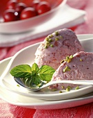 Cherry mousse with pistachios and mint