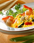 Colourful paella with seafood, vegetables & strips of ham