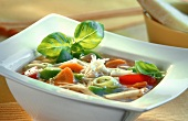 Minestrone in square china plate