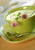 Béchamel sauce with herbs; chive flowers