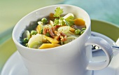 Mixed vegetable soup served in a cup