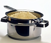 Cooked couscous in pot