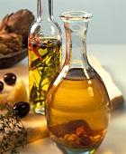 Bottle of aromatised vinegar & bottle of herb oil