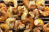 Shrimps with lemon and oil marinade on the barbecue