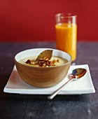 Potato soup with pecan nuts & a glass of multivitamin juice