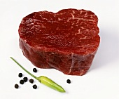 A slice of beef fillet, peppercorns & green chili pepper